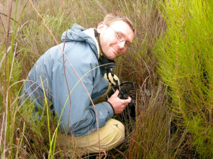 NSF Division of Environmental Biology Program Officer Simon Malcomber photographing the Western Australia pitcher plant in Western Australia.