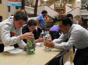 Einstein Fellow Kevin Tambara (NSF CISE/CNS) engages students in a lesson on buoyancy.