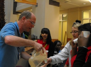 BIO/DEB Program Officer Doug Levey serves students a drink of milk to take the edge off after chili pepper tasting.